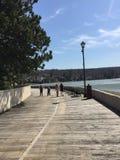Kids Walking On Boardwalk By Lake Stock Image