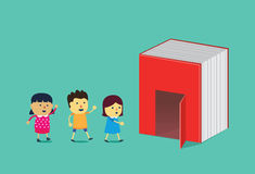 Kids walking into the door of big book. Stock Photo