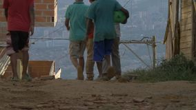 Kids walking in a poor neighborhood in Medellin, Colombia - July 2017 stock video footage