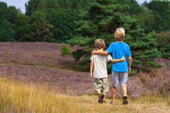 Kids walking on heathland Royalty Free Stock Images