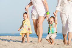 Kids walking with her mother and grandmother Royalty Free Stock Photo