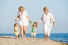 Kids walking with her mother and grandmother Stock Photography