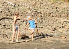 Kids walking in mud Stock Images