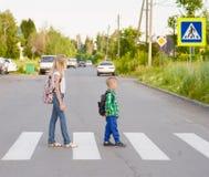 Kids walking on the pedestrian crossing Stock Photo