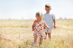 Kids walking on rural background Stock Image
