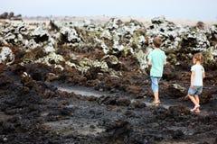 Kids walking at scenic terrain. At Galapagos islands, Ecuador stock images