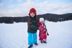 Kids walking on snow Stock Photos