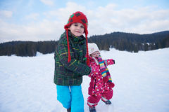 Kids walking on snow Royalty Free Stock Photo