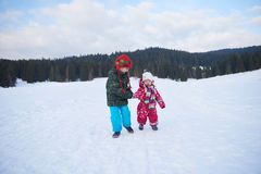 Kids walking on snow Stock Photo