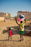 Kids walking in the street of Mopti Royalty Free Stock Photography