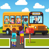Kids walking to and getting on school bus Royalty Free Stock Photo
