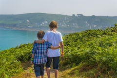 Kids walking towards the sea Royalty Free Stock Photography