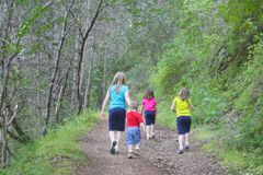 Kids walking on the trail Royalty Free Stock Images