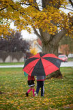 Kids Walking with Umbrella Stock Photo