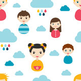 Kids wall paper pattern. Color children smiling faces and clouds. Royalty Free Stock Photo