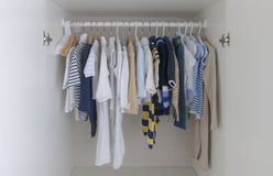 Kids wardrobe. Open kids male wardrobe collection in closet stock images