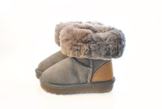 Kids warm winter boots in gray fur with a lapel. Stock Images