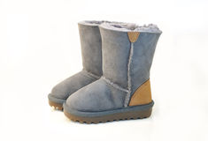 Kids warm winter gray boots isolated. Royalty Free Stock Photos