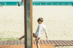 Kids washing in the beach showers. Kids washing the sand, in the beach showers royalty free stock image