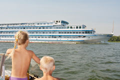 Kids watching the big cruise ship Royalty Free Stock Image