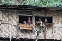 Kids watching from the hut window Royalty Free Stock Images