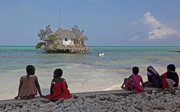 Kids watching Indian Ocean from East coast of Zanzibar, Tanzania Stock Photo