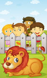 Kids watching lion Stock Photo