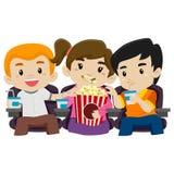 Kids Watching Movie while Eating Popcorn Stock Photo