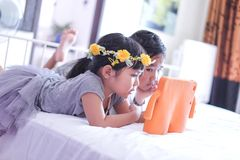 Kids watching online video on tablet stock images