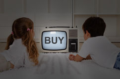 Kids watching television - mental imprinting stock photos