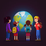Kids watching terrestrial globe at science museum. Group of kids girls, boys watching big earth terrestrial globe model at geological science museum excursion Royalty Free Stock Image