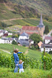 Kids watching view Germany village with old church Royalty Free Stock Images