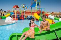 Kids at a water park. A boy and a girl on the slide at a water park Royalty Free Stock Images