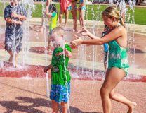 Kids in Water Park. Picture of kids playing on a splash pad on the River Walk in Montgomery, Alabama during the Second Saturdays event stock photo