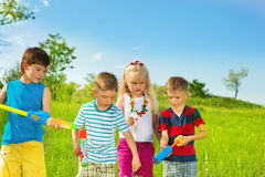 Kids with water pumpers. Kids group with water pumpers Royalty Free Stock Photos