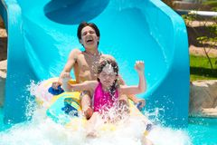 Kids on water slide  Stock Photography