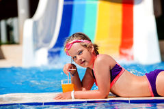 Kids on water slide at aquapark. Royalty Free Stock Images