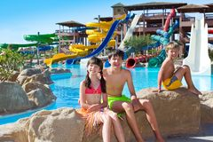 Kids by the water slides Royalty Free Stock Images