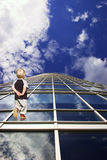 Kids way to future. Child and his path to future. Perspective of skyscraper windows Stock Image