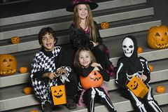 Kids Wearing Halloween Costumes On Steps Royalty Free Stock Images