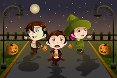 Kids wearing Halloween costumes. A vector illustration of Little kids wearing Halloween costumes going out for trick or treat Stock Photography