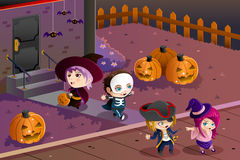 Kids wearing Halloween costumes. A vector illustration of Little kids wearing Halloween costumes going out for trick or treat Stock Photos