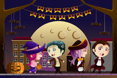 Kids wearing Halloween costumes. A vector illustration of Little kids wearing Halloween costumes going out for trick or treat Royalty Free Stock Images