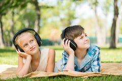 Kids wearing headphones Stock Photo