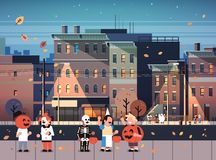 Kids wearing monsters costumes walking night town holiday concept cityscape background tricks or treat happy halloween. Cartoon character full length horizontal stock illustration