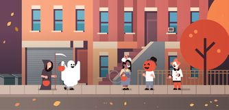 Kids wearing monsters ghost pumpkin wizard clown costumes walking town holiday concept tricks or treat happy halloween. Cartoon character full length horizontal vector illustration