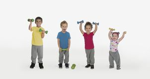 Kids with weights and one funny boy royalty free stock image