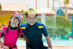 Kids in wetsuits and masks Stock Images