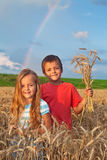 Kids in wheat field at harvest time