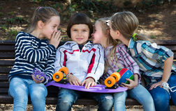 Kids whispering in other ears Stock Photography